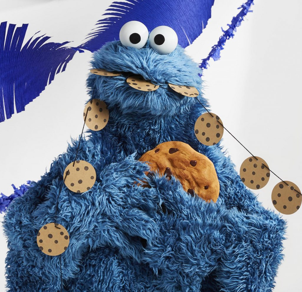 Cookie Monster thinking twice about eating all those cookies